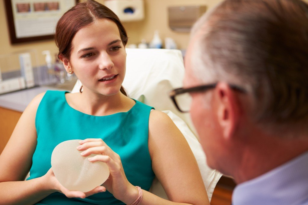 Woman Discussing Breast Augmentation With Plastic Surgeon